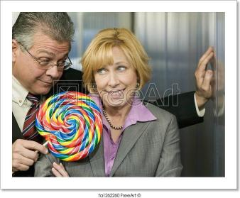 man-in-office-offers-coworker-a-lollipop